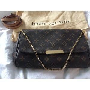 Louis Vuitton MM Monogram Clutch